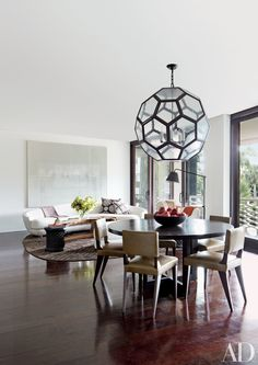 A large lantern hangs above the table in the dining area | archdigest.com