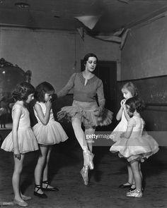 Russian ballet dancer Tamara Karsavina (1885 - 1978) with four young pupils at her dancing studio.
