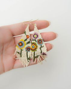 Beige beaded earrings with colorful flowers, Mismatched earrings, Abstract jewelry, Asymmetric earri Seed Bead Earrings, Diy Earrings, Crochet Earrings, Hoop Earrings, Seed Beads, Pearl Earrings, Beaded Earrings Patterns, Beaded Jewelry, Bracelets