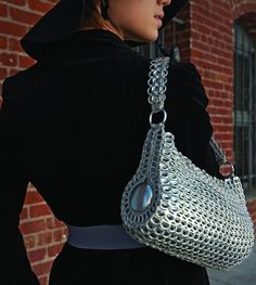 'Danubia' Shoulder Bag $145.00 Sustainably designed metallic handbag made of recycled aluminum and crochet. The bag's gussets are made from soda can bottoms. CAN be DIY