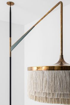 LAMPADA 027DIMORESTUDIO,PROGETTO NON FINITO2015Floor/ceiling lamp in matte black and semigloss green painted metal.Lampshade and detailing in oxidised brass. Silk fringe.w.47 x d.230 xh.400cm