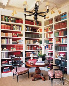 Public-relations executive Mike Clifford brought drama to the library he created in the entry of his Hollywood Hills house by painting the walls backing the bookcases in a Farrow & Ball red. (November 2005) - ELLEDecor.com