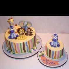 I love the strips of fondant on the side of the cake and adorable animals.
