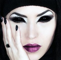 She's got the looks that kill! An Evil, Sexy look, and ready to break a many hearts. A makeup idea paired with black sclera contacts => http://www.pinterest.com/pin/350717889705707881/