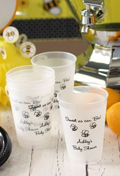 Use these plastic cups as both baby shower decorations and guest favors. Set them next to your drink or punch table for guests to use and then take home with them as souvenirs later. These work awesome as party decorations and look fabulous displayed next to a drink station or buffet table. Have a cute baby design like the bee theme shown and your own thank you message custom printed. Available in 7 cup sizes. Order at http://www.tippytoad.com/personalized-frosted-baby-shower-cups.asp