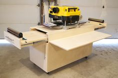 "A custom planer bench I designed and built the out feed tables support up to 150lbs. and offer full extension 22"" ball bearing slides, side table supports loads up 100Lbs per each collapsable arm, castors are commercial and all lockable."