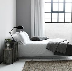 Beautiful, perfect, white and black small bedroom.