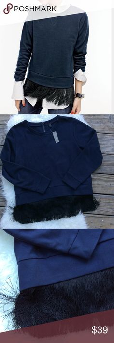 "J. Crew Fringe Bottom Sweatshirt New with tags J.Crew black fringe bottom navy sweatshirt with exposed back zipper. 56% cotton 44% polyester. Tassels are nylon. Size XL. Slightly loose fit. 46"" bust, shoulder to shoulder 18"", sleeve length 24"". No trades, offers welcome. J. Crew Tops Sweatshirts & Hoodies"