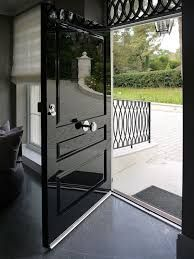 One of the first things about a house that a guest or home buyer notices is the front door. If you want to make a statement, upgrading or revamping your front door is a smart move that isn't all th… Black Front Doors, Wooden Front Doors, Painted Front Doors, Front Door Entrance, Entry Doors, Oak Doors, Doorway, Entryway, Door Paint Colors