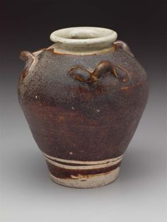 Pot Vietnam, Le dynasty, 15th–16th century Stoneware with brown glazes, carved decoration, applied handles, 12 x 11 cm MFA, 2002.759