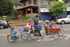 Pedal power: Mum takes six children to school on one bicycle!
