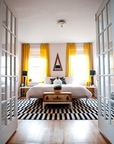Bedroom bliss. Yellow curtains. Striped rug.
