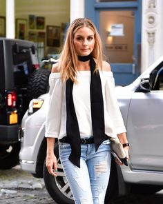 Olivia Palermo in an off-the-shoulder top, skinny jeans, and long skinny scarf