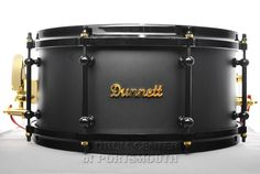 Dunnett Classic Tourbillion Titanium Anniversary Snare Drum 14x6.5 Dunnett Classic Tourbillion Titanium Anniversary Snare Drum 14x6.5 - Flat black titanium shell, black tube lugs and cast hoops, gold-plated R4 strainer/butt, washers, and logo! Deluxe Ahead gig bag included. Available for purchase here! http://www.drumcenternh.com/dunnett-classic-tourbillion-titanium-anniversary-snare-drum-14x6-5.html