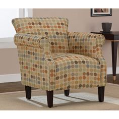 This circle-patterned armchair features a multitude of neutral-colored polka dots along with stunning espresso-finished wooden legs. The soft hues this chair offers will add a cozy look to your room. The foam padding offers great comfort and support.