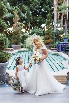 The sweetest bride + flower girl moment: http://www.stylemepretty.com/california-weddings/los-angeles/2016/01/29/whimsical-fall-four-seasons-los-angeles-wedding/ | Photography: Jana Williams - http://jana-williams.com/
