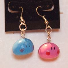 A set of earrings, made from polymer clay, of the Dango family from Clannad