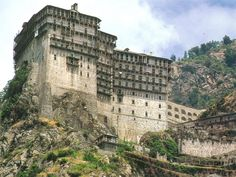 Holy Monastery of Simonopetra on Mount Athos. The Holy Mountain, Unique Architecture, Turquoise Water, Place Of Worship, 14th Century, World Heritage Sites, Rocky Mountains, Mount Rushmore, Cathedral