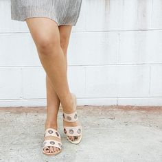 Slide right into the new season in style with this leather sandal. Featuring decorative metal rings and a sleek multi-strap design this sandal will look great with easy-to-wear summer pieces. Shop 'Hannah' by Sol Sana online at Styletread | Slides | Flats | Sol Sana | Summer | Sandals | Flats | Street Style | Pastels