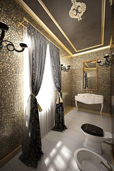 This smaller bathroom features gold and black patterned tile walls and ceiling, plus a claw foot vanity in white for high contrast.