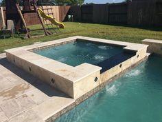 Geometric Spa with glass tile flat spillway. Beautiful tiramisu travertine veneer! By Kyle Franco with Premier Pools & Spas Houston
