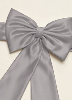 """Beautiful satin flower girl sash.  Satin flower girl sash with back bow.  Measures: Sash - 28""""L x 1.75"""" W. Bow - 7.75"""" L x 4.75"""" W.Ribbon on bow - 21"""" L.  Imported."""
