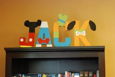 child's name in cardboard letters painted like Mickey Mouse characters