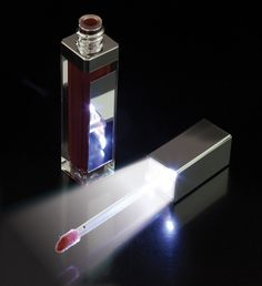 Lip Gloss with LED lighting - Everyone woman must have one of these....a mini flashlight and mirror for your lip gloss!