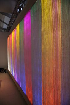 Light tapestry by Denmark-born designer Astrid Krogh.  The one shown here is called IKAT III. It's made of optic fiber, paper yarn and light monitors.