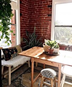 Dining room ideas - brick wall, wood and plants