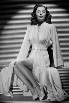 Barbara Stanwyck. Gosh, STUNNING woman! This was one of my all-time favorite eras for style and for film.