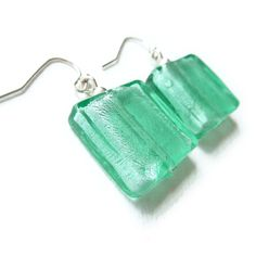 --- The square, glass drops are created by fusing a delicate layer of silver foil between squares of aqua coloured glass. The inner silver layer giv.
