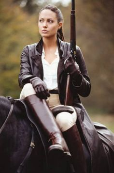 angelina jolie rides side saddle for tomb raider.