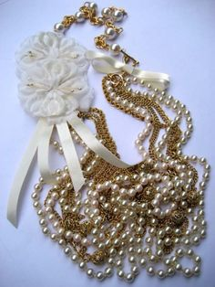 Vintage millinery flower and pearl necklace, good way to use up some of the old chain and lace and the old flowers