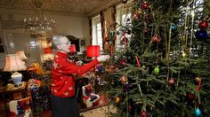 Queen Margrethe decorating the Christmas tree at Marselibourg Palace
