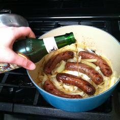 Beer Bratwurst and Onions  1 package Johnsonville Bratwurst  1 onion, sliced  dab of butter  1 dark beer  1-2 tbsp brown sugar  Your choice of hot dog buns  Spicy mustard  Pot  then grill