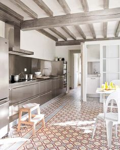 modern french counrty kitchen with stainless steel, grey washed wood, and amazing decorative tile floors