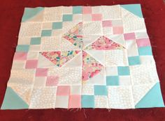 """My latest Quilt as you go block. 9 of these 18 inch blocks to the quilt. I want to quilt it in an all over motif of daisy type flowers. The pattern is called Diamond Blade, pg 43 ofthe book """"200 Blocks from Quiltmaker magazine. I changed the 4 patches to 2 different colors to add interest, and because that's what I had on hand."""