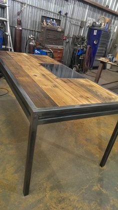 The Apex is a custom desk with steel work on the sides and a steel writing plate on the top.  www.metalfred.com