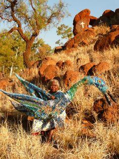 Tjunkaya Tapaya (Ernabella Artist) with her blue Tjanpi Tjulpu (bird)