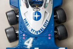 """The famous Tyrrell """"six-wheeler"""" racecar from the 1976 and 77 seasons. Currently on display at the Canepa Motorsports Museum. Formula 1 Car, F1 Season, Checkered Flag, Motor Car, Scale Models, Grand Prix, Hot Wheels, Race Cars, Cool Things To Buy"""
