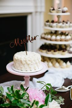"""Simple wedding cake idea - one-tier wedding cake with textured frosting and wooden """"Mr & Mrs"""" cake topper {Meredith Sledge Photography}"""