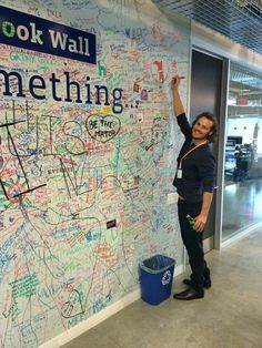 Sam at Facebook setting up his official FB page and signing the FB wall!