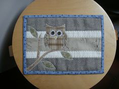 Owl Mug Rug - this may be a great beginner project for someone (me) who is interested in the idea of quilting. I may try a project like this. Nice and small.