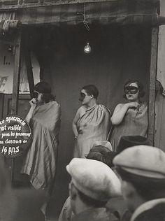 Paris street fair, 1931, by Brassai.