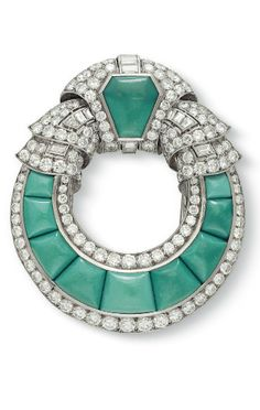 AN ART DECO DIAMOND AND TURQUOISE BROOCH Designed as an openwork cabochon turquoise plaque of circular outline, trimmed with circular and baguette-cut diamonds, mounted in platinum and 18k white gold, with French assay marks and maker's mark (partially indistinct), circa 1930