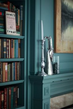 love the color of the walls... and the books, and the bit of painting I can see!