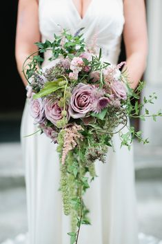 Very pretty bridal bouquet. I might not have the vine down but I love the colors and style. #weddingideas #weddingflowers