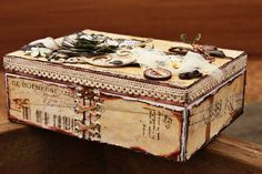 cigar box..  I like the ribbon fashioned to look like a corset.