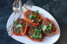 Vegan Quinoa Stuffed Peppers -- this recipe was simple, but turned out really good. The mods: purple kale for spinach, TVP for black beans, fresh tomato + tomato paste for can of diced tomatoes, and no cilantro, cuz I don't have the patience to pick each annoying leaf off of the bunch (there, I said it!).